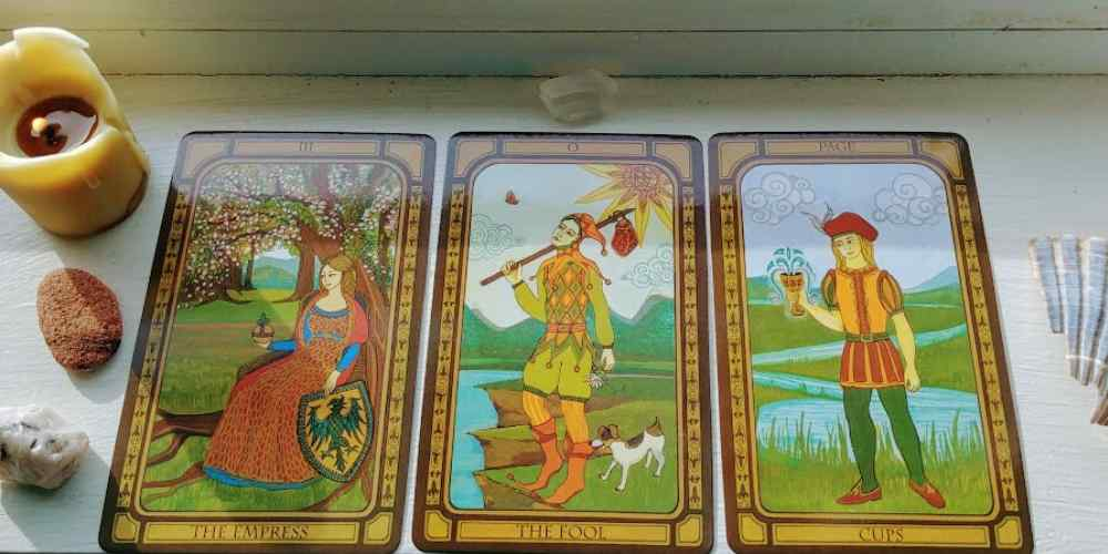 The Golden Tarot by Liz Dean. Featuring The Empress, The Page of Cups, and The Fool